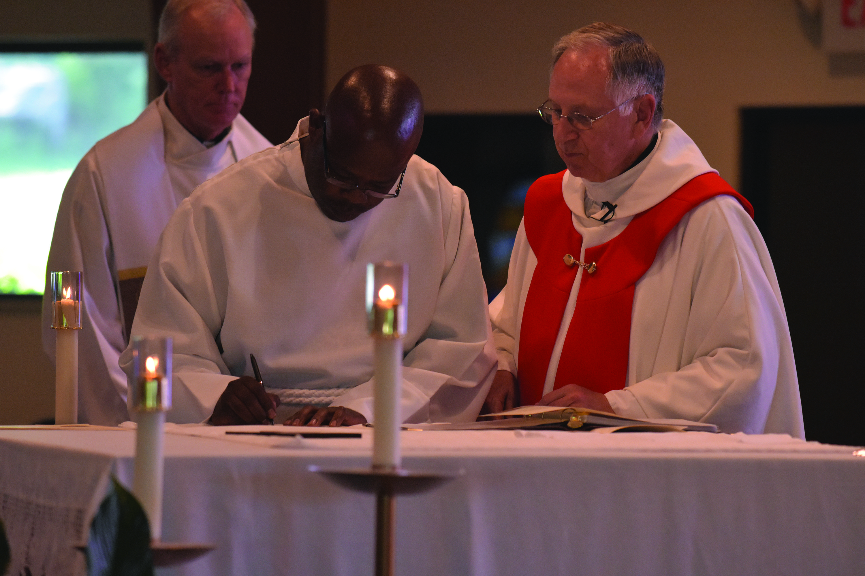 3 men profess oaths, ordained for Glenmary